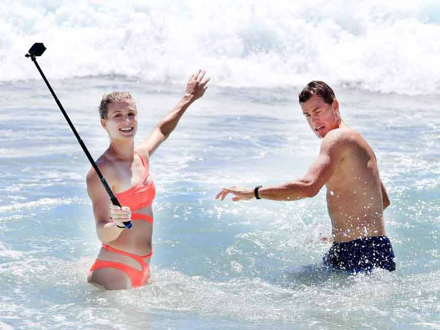 Eugenie-Bouchard-trying-to-take-selfie-with-a-friend-in-swimsuit
