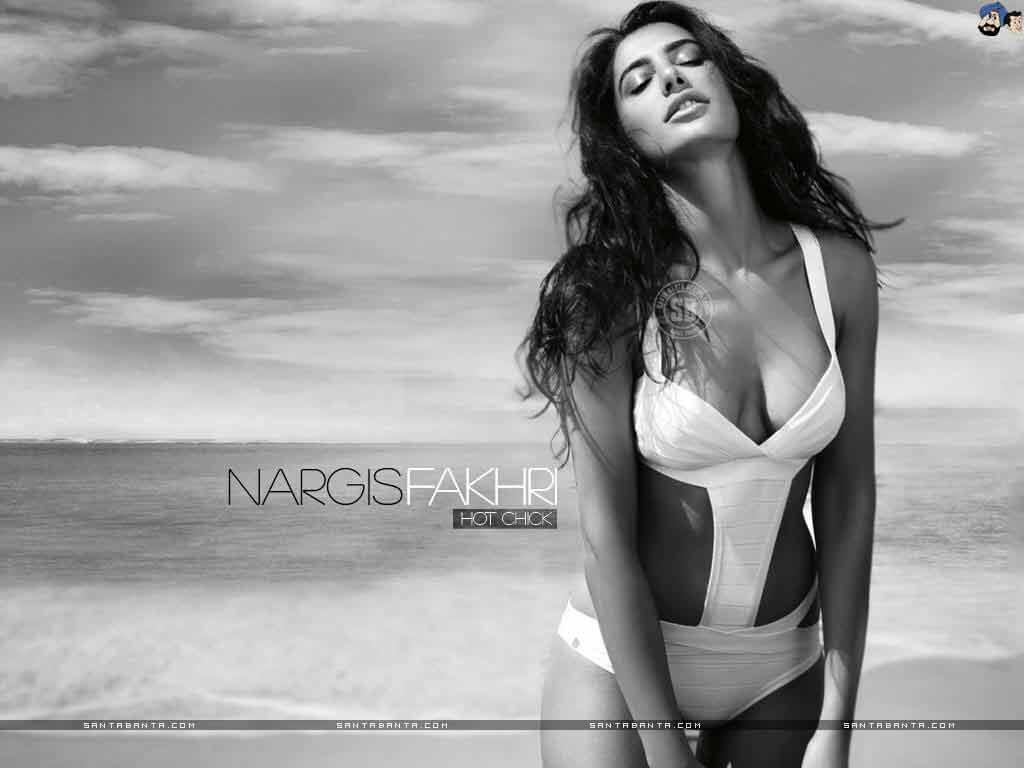 Nargis Fakhri Sizzles in white bikini on beach seductive look