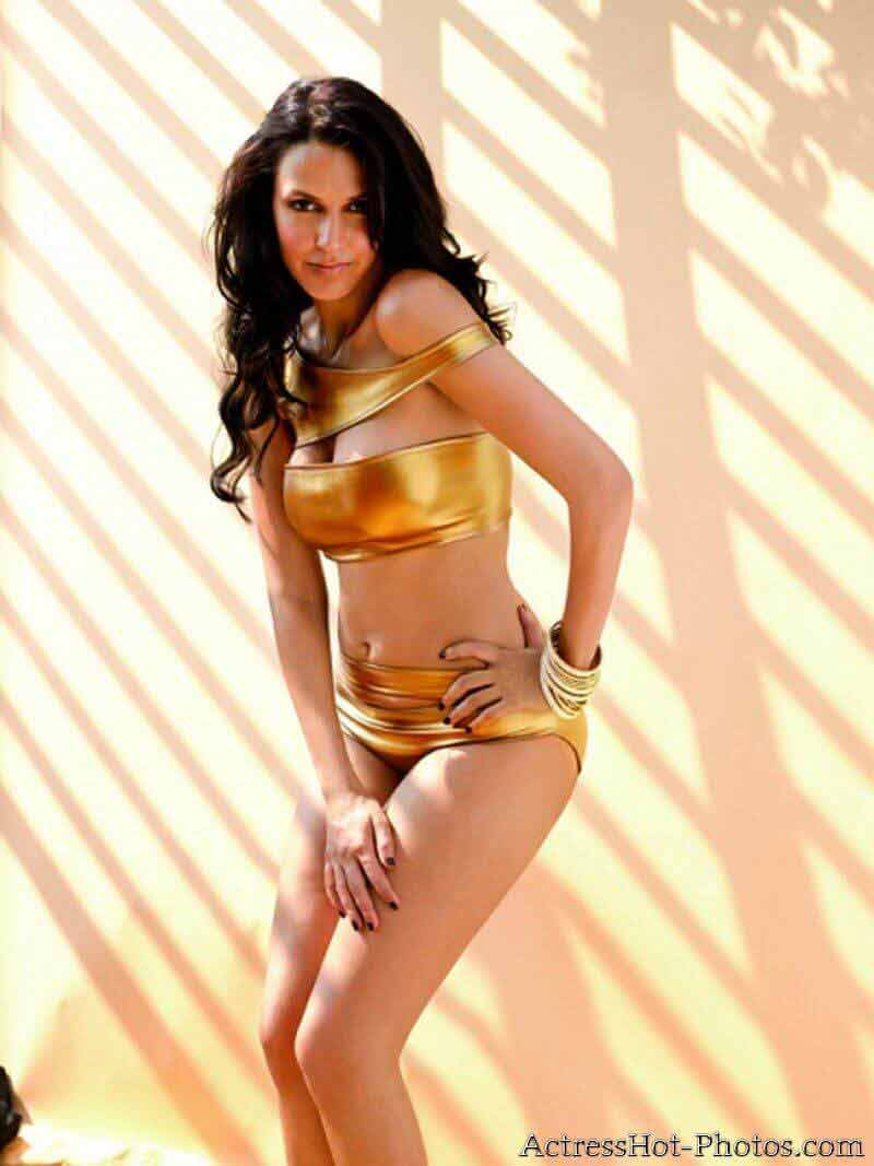 Neha dhupia boobs are popping out from her golden bikini