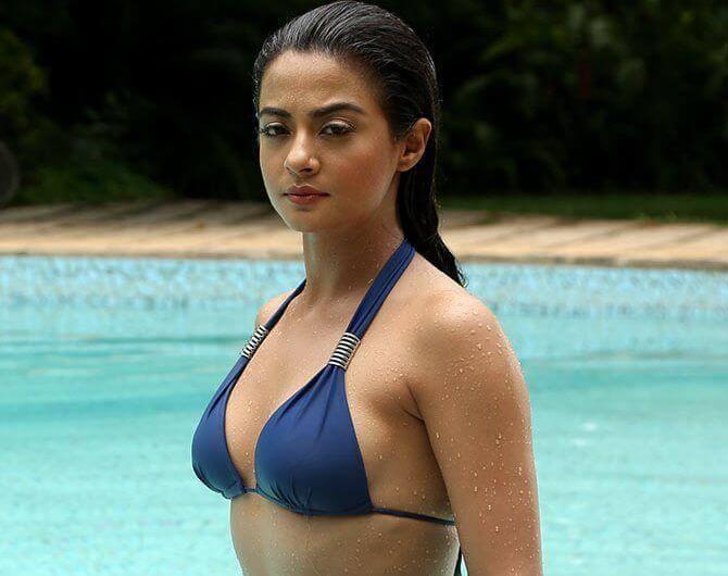 surveen chawla sexy boobs in blue bikini