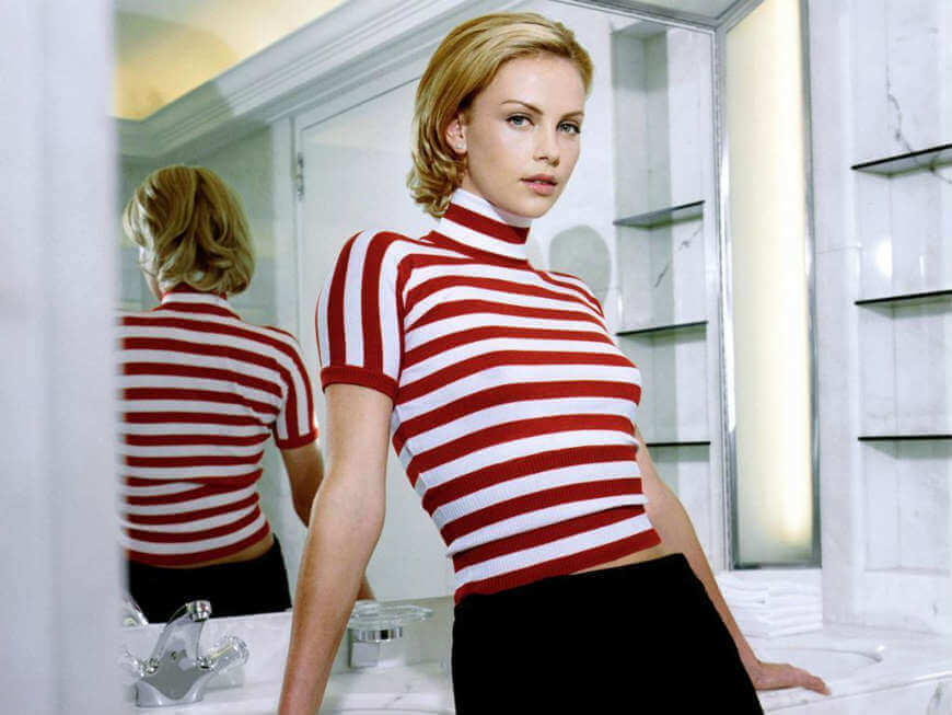 hollywood actress charlize theron hd photos spreading her beauty all over the place