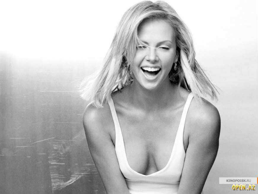 Charlize Theron deep cleavage photos