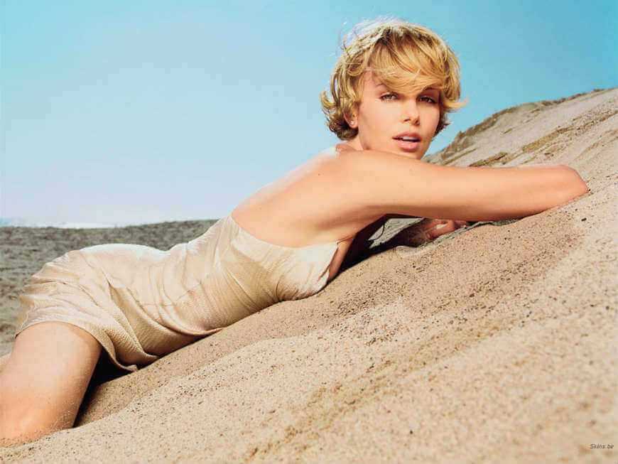 charlize theron photos clicked lying on sand