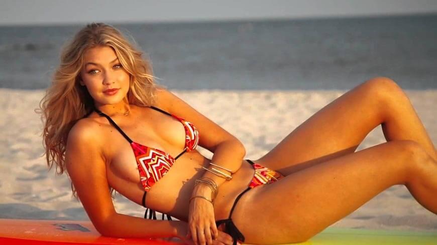 gigi-hadid-bikini-pictures-photos-lying-on-beach-in-red-printed-bikini-with-her-cute-smile