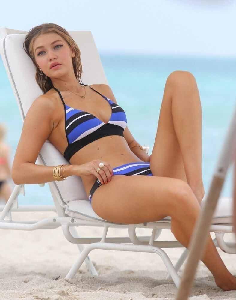 gigi-hadid-bikini-blue-bikini-swimsuit-lying-on-chair-in-beach-sexy-look-in-blue-bikini-images