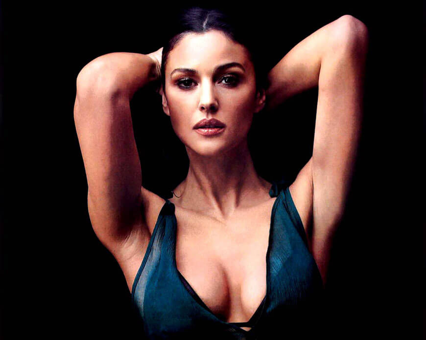 Sensual Look of Monica Bellucci tight top and panty show off her curvy boobs