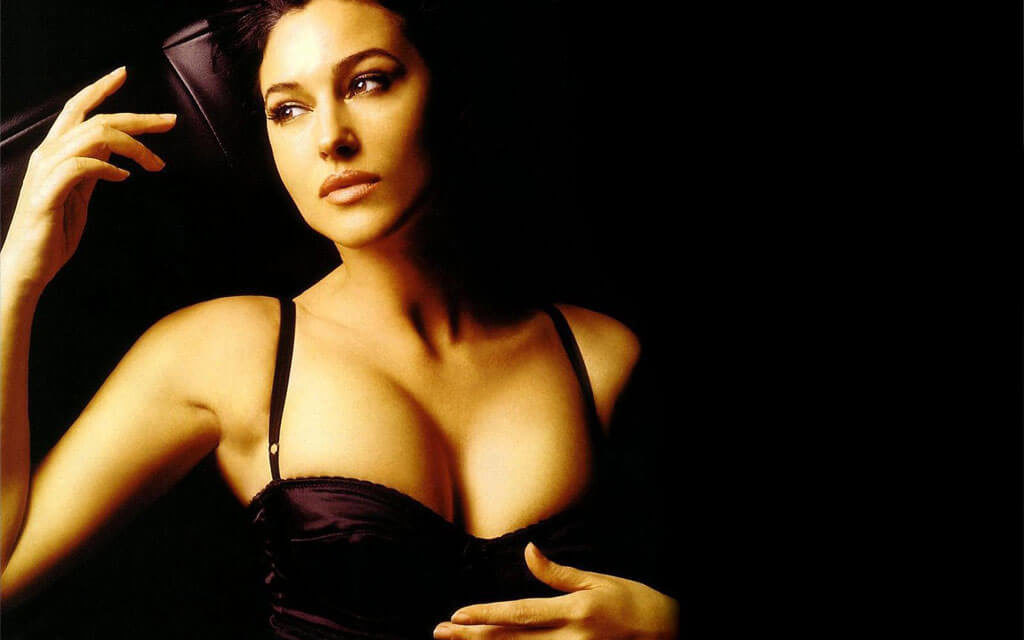 actress monica bellucci hot hd photos her boobs popping out of her dress