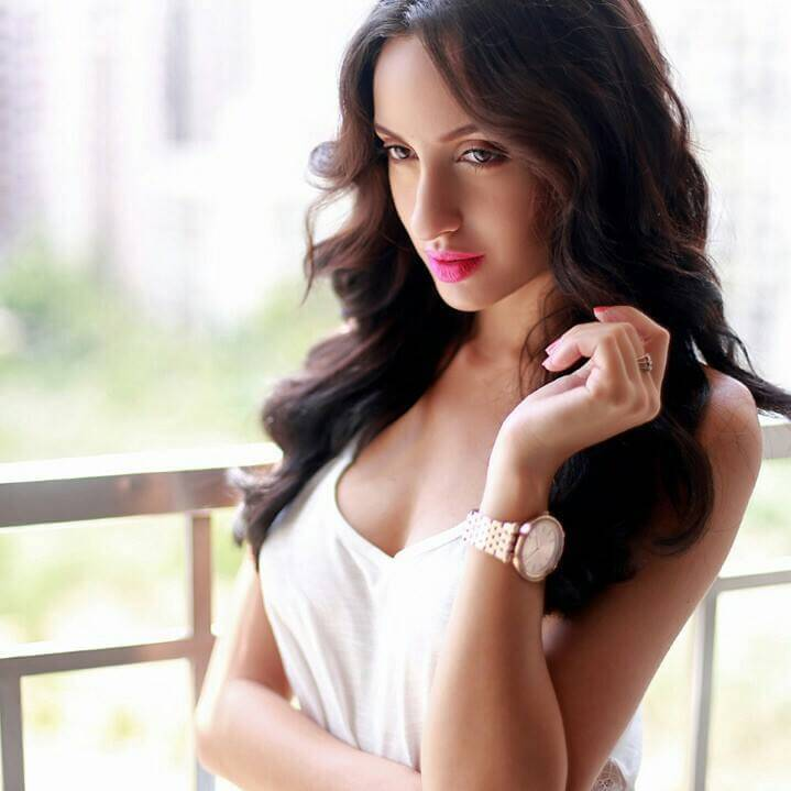 nora-fatehi-hot-images-looking-cute-in-white-shirt