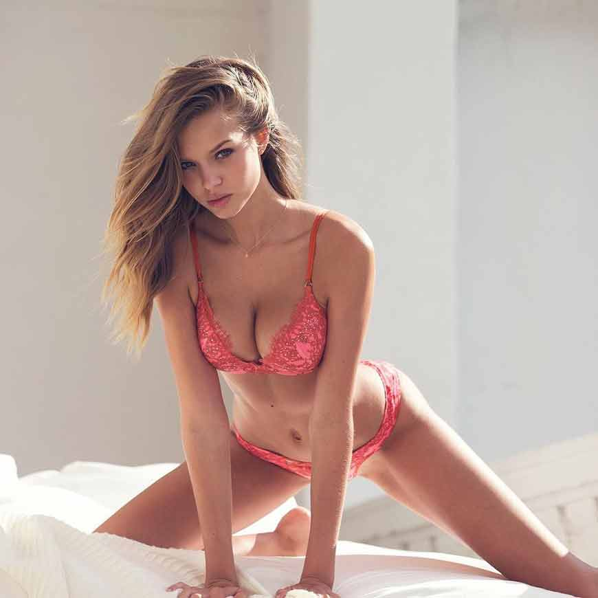 sexy-josephine-skriver-in-bikini-lying-on-bed-exposing-her-deep-cleavage