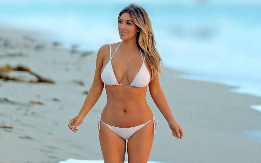 kim kardashian flaunting her body in white bikini