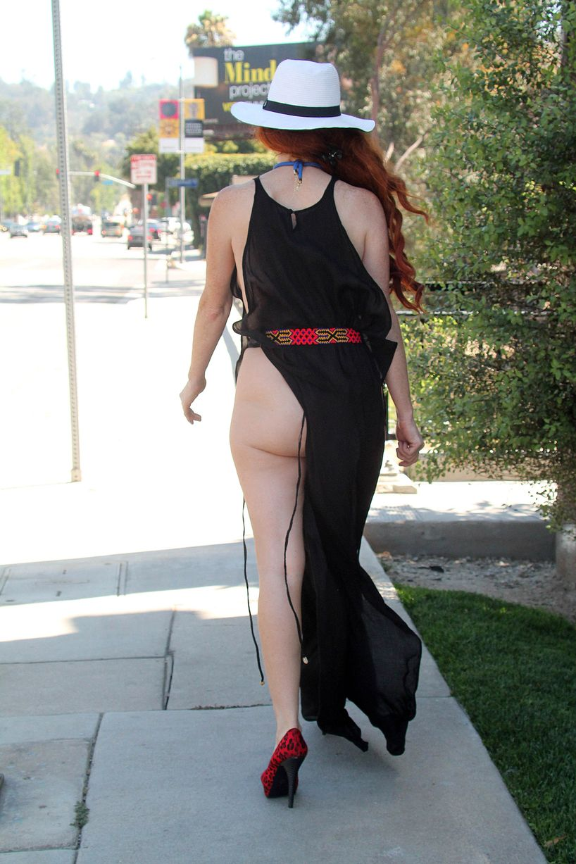 sexy phoebe price walking on street wearing net outfit
