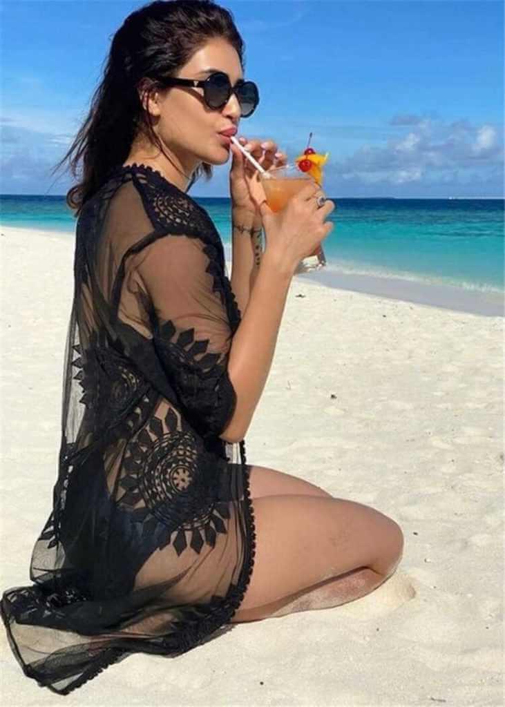 Karishma Tanna Bikini Photos Enjoying Juice on Beach