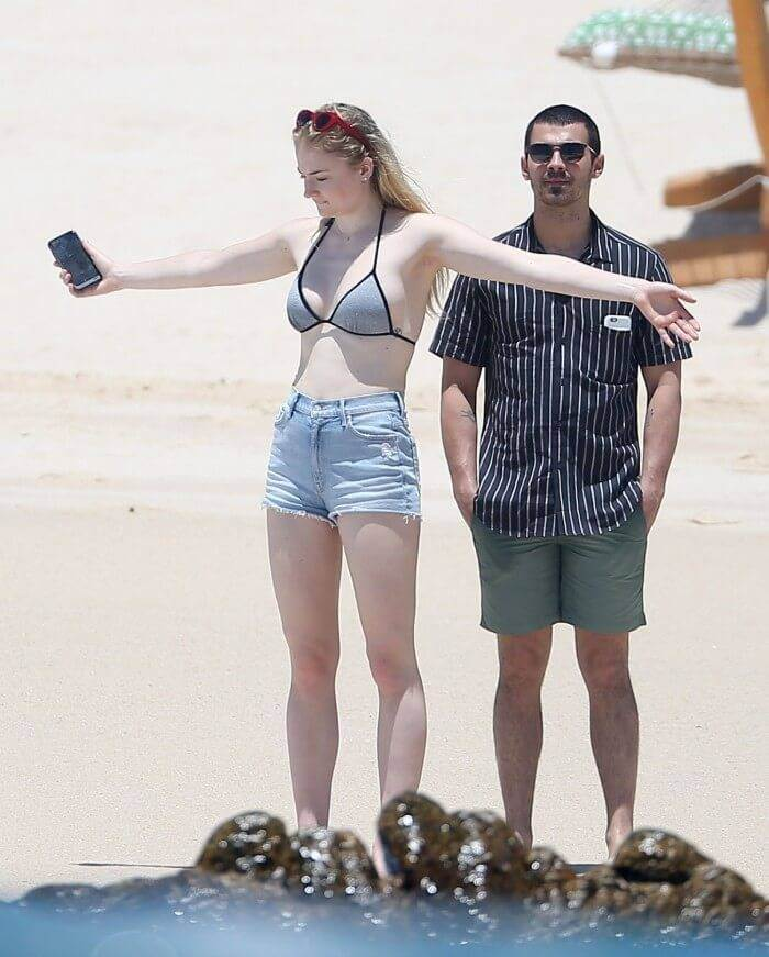 hollywood sophie turner in bikini bra on beach wearing bikini bra with denim shorts