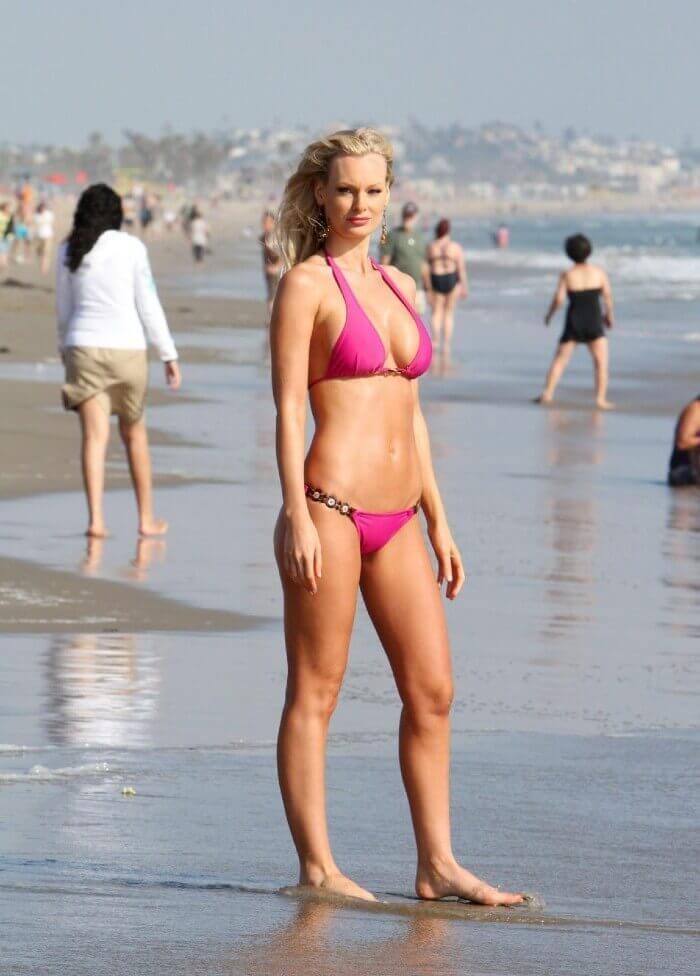 hot sophie turner in bikini on beach displaying her toned figure