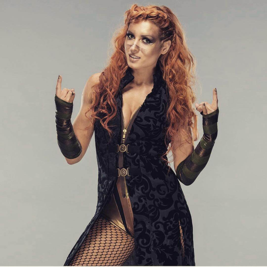 Becky-Lynch-Photoshoot-sexy-toned-legs-in-bikini