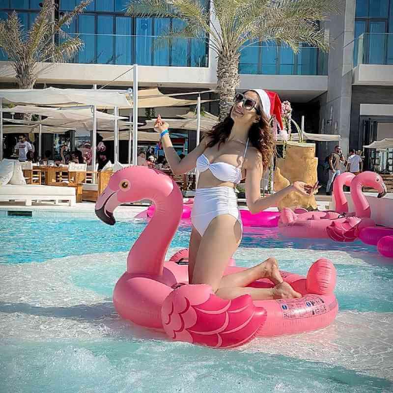 Raai-Laxmi-having-fun-in-pool-in-white-bikini