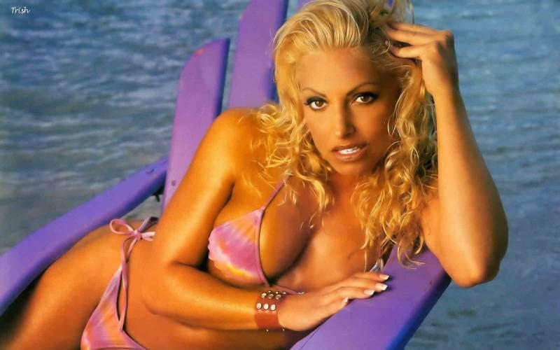 Trish-stratus-in-bikini-showing-huge-deep-cleavage-in-photos