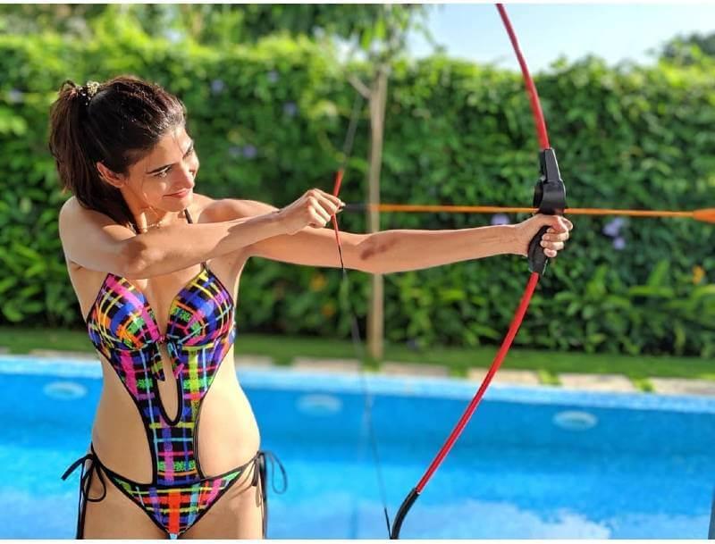bollywood-actress-aahana-kumra-tyring-to-shoot-the-arrow-with-bow-in-bikini-swimsuit