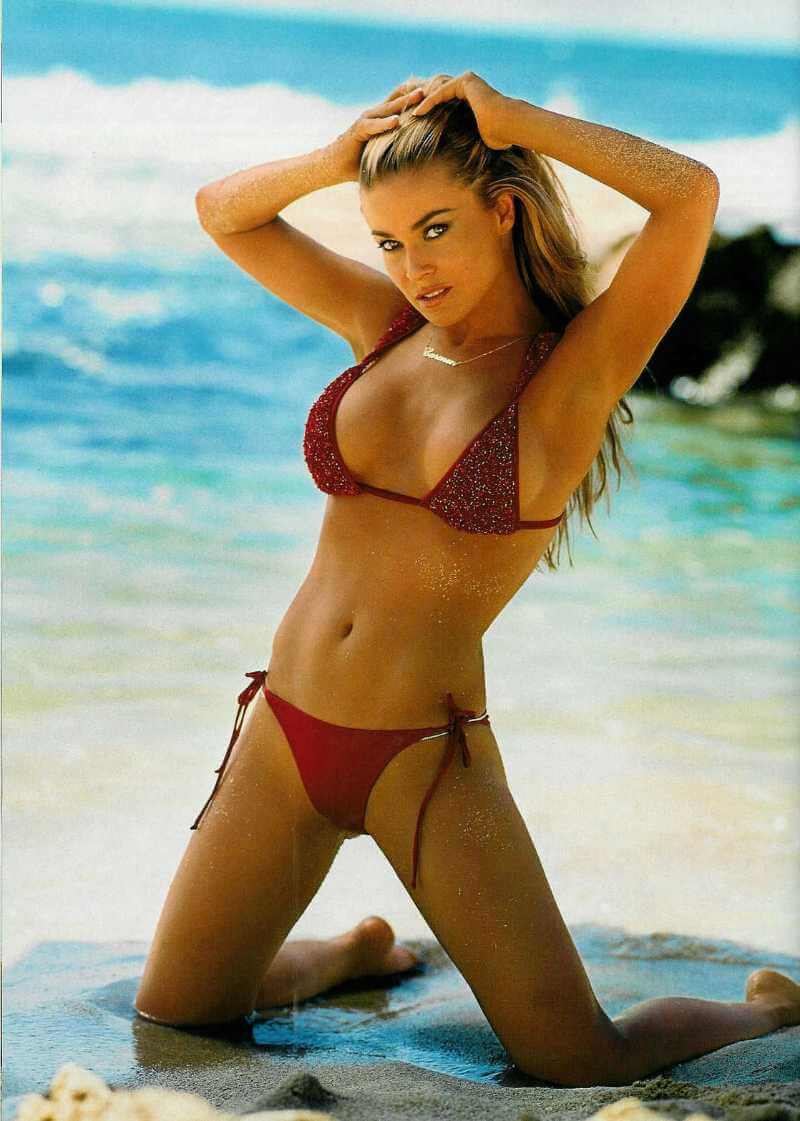 carmen-electra-displays-her-bikini-body-in-red-swimsuit-on-beach