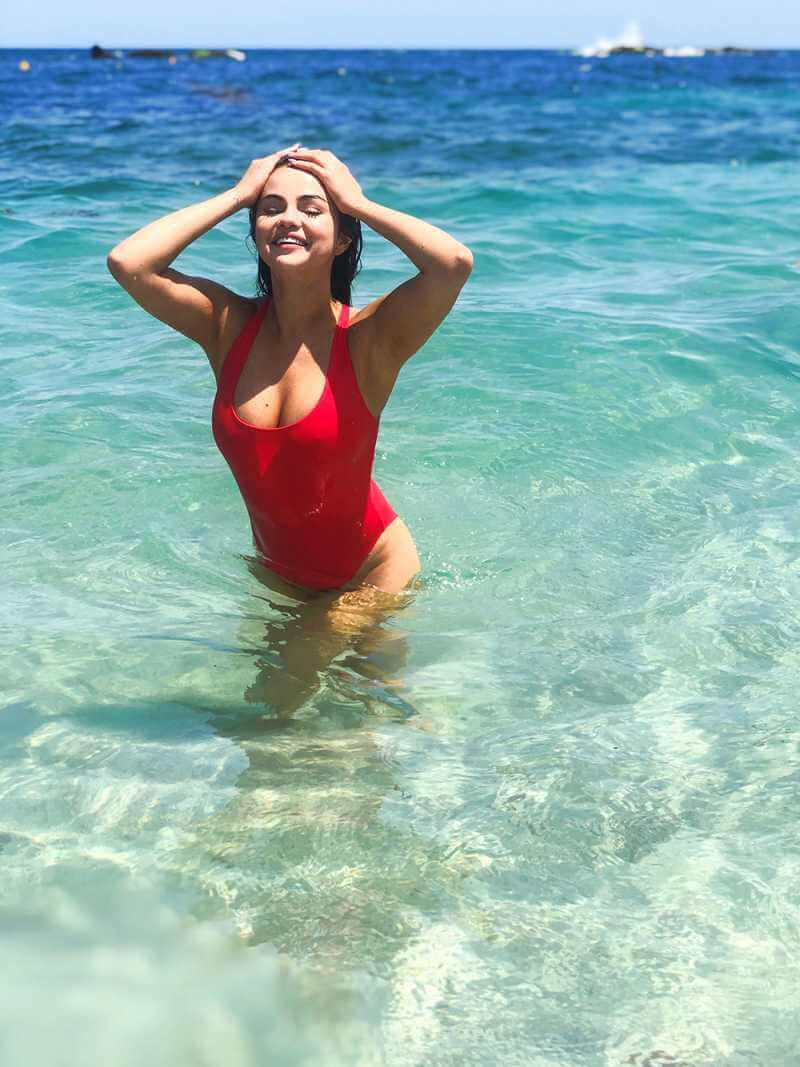 selena-gomez-red-swimsuit-photos-looking-hot-in-water