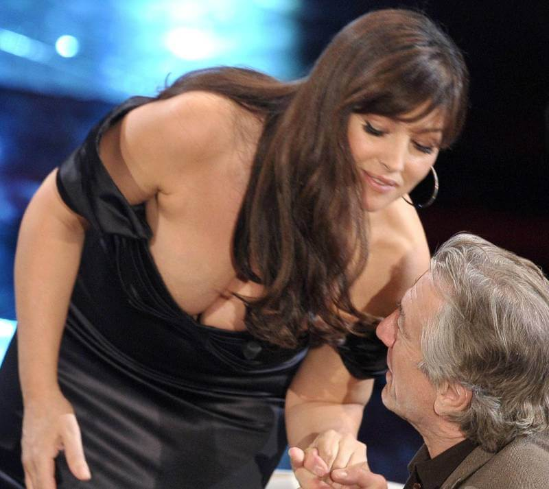sexy-huge-cleavage-pictures-of-monica-bellucci-captured-in-a-tv-show-while-host-stairing-at-her-boobs