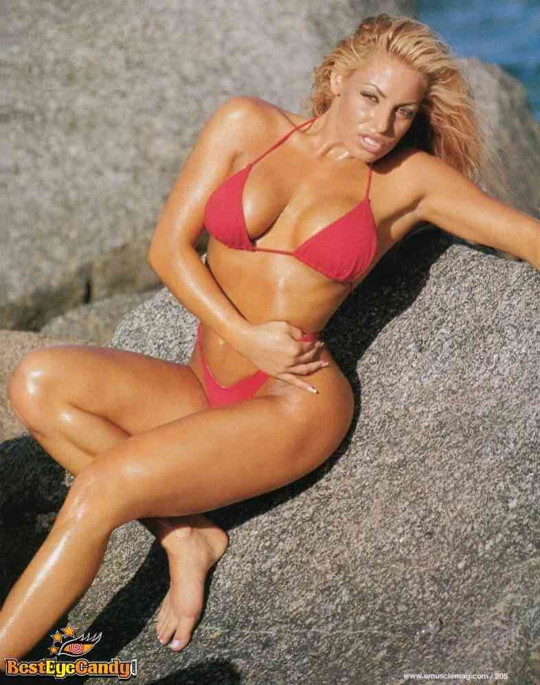 trish-stratus-red-bikini-photoshoot-showing-her-assets.
