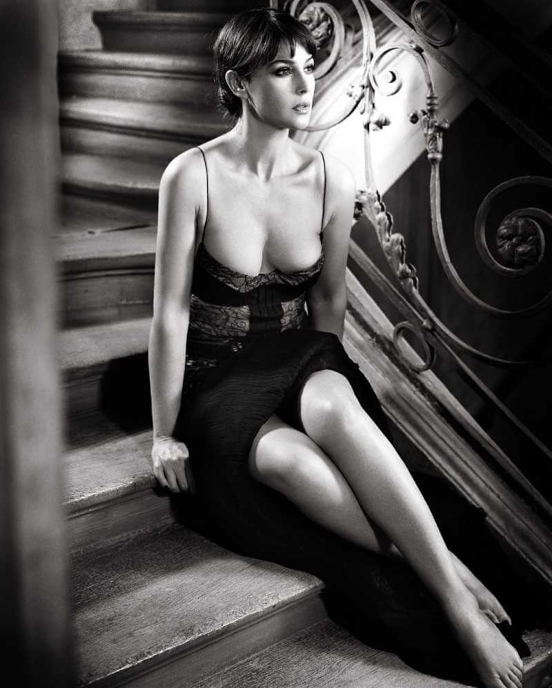 women-actress-brunette-portrait-display-stairs-monica-belluci-wearing-sexy-dress-showing-huge-cleavage-and-long-legs