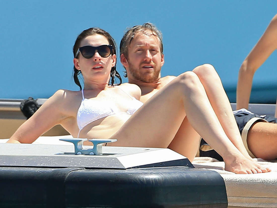 Anne-Hathaway-in-Bikini-lying-on-yatch-with-husband