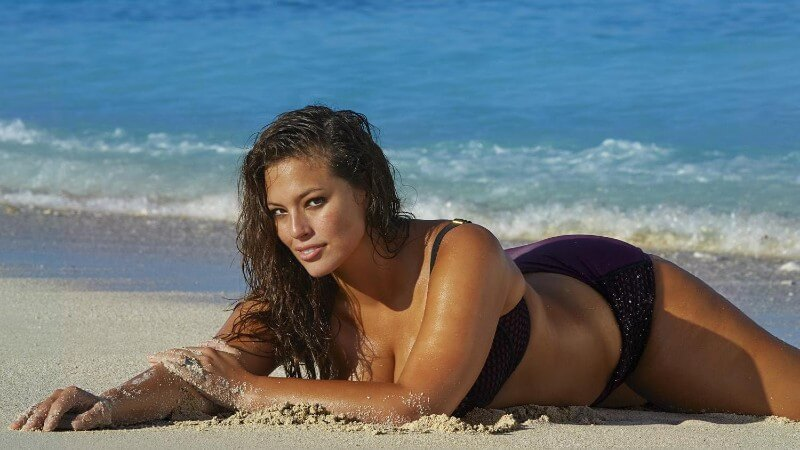 Ashley-Graham-Outtakes-SI-Swimsuit-lying-on-beach-sand