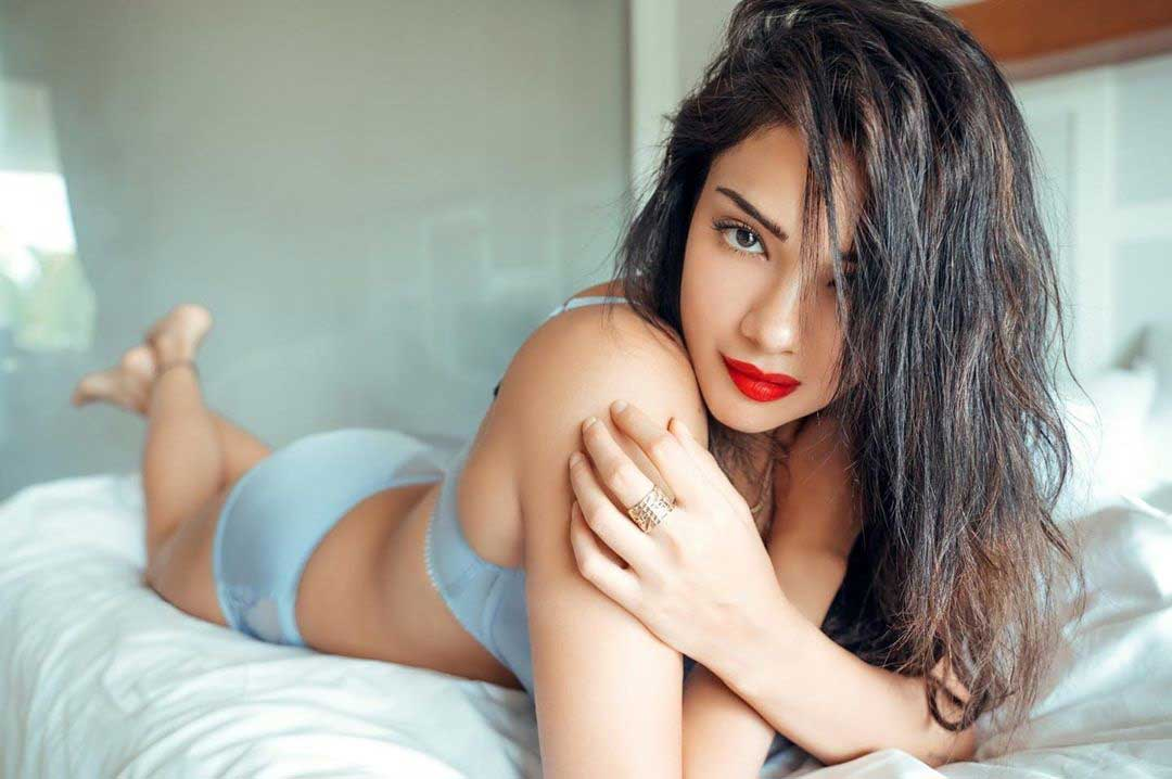 Hot-Megha-Gupta-bikini-pictures-lying-on-bed