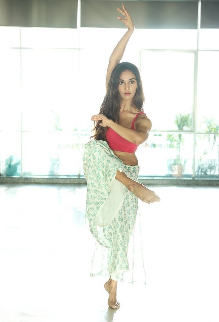 Mukti-Mohan-wearing-red-sports-bra-in-dance-pose