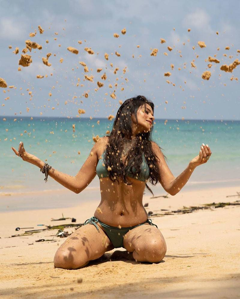 actress-megha-gupta-in-bikini-playing-with-sand-on-beach