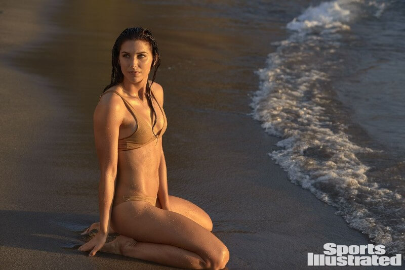 alex-morgan-hot-fit-body-bikini-images-lying-on-beach-in-sports-illustrated-swimsuit-photoshoot