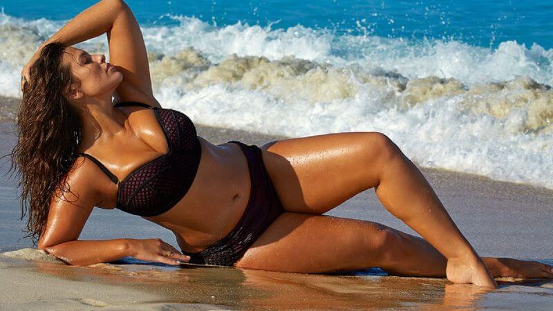 ashley-graham-posing-at-beach-in-bikini-for-magazine