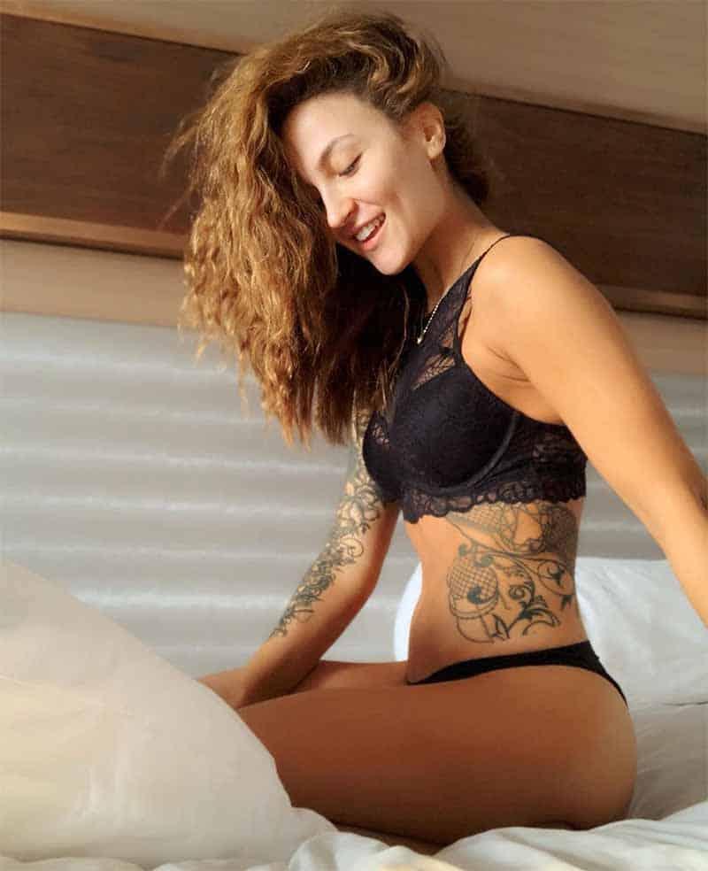 elli-avram-in-bikini-on-bed