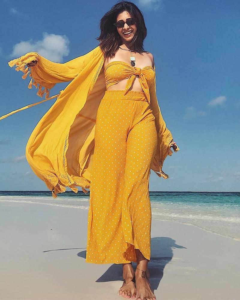 kishwer-merchant-smiles-wearing-bikini-top-dress