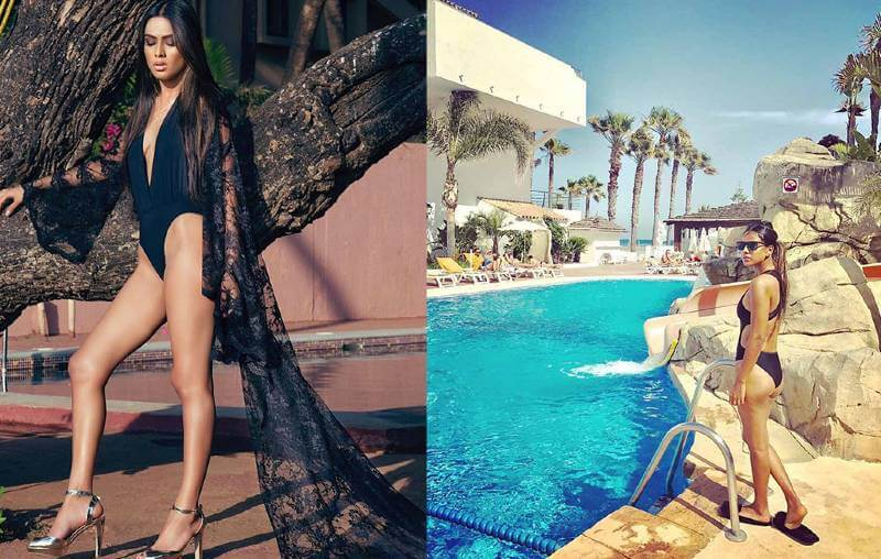 nia-sharma-showing-her-zero-figure-in-black-bikini-swimsuit