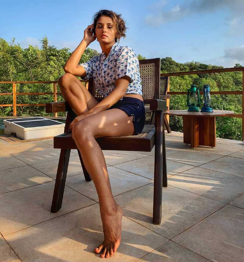 shakti-mohan-in-bikini-shorts-showing-her-legs