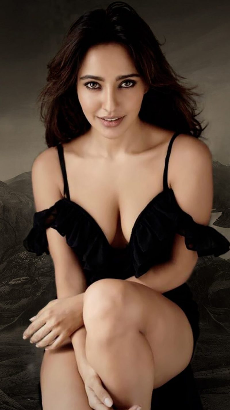 Neha-Sharma-Sizzles-in-Black-Dress-show-deep-cleavage