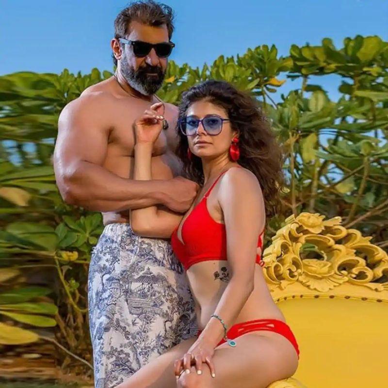 hot-actress-pooja-batra-poses-in-a-red-bikini-with-a-shirtless-hubby-nawab-shah