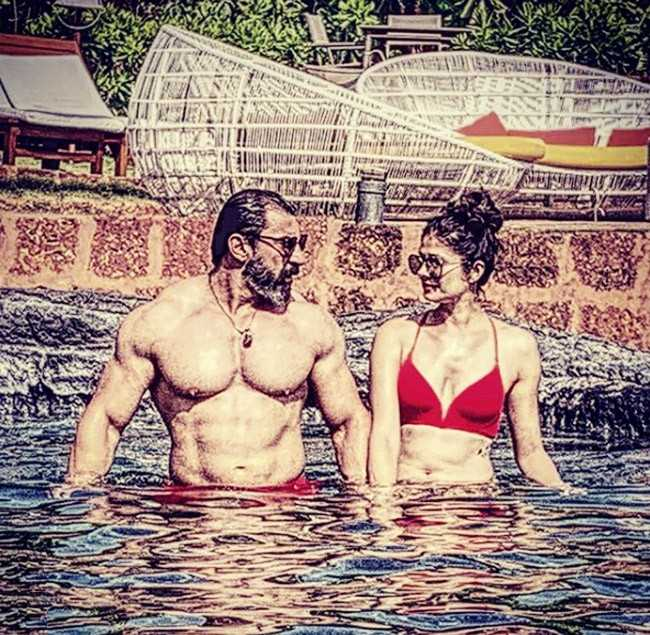 sizzling-pool-picture-of-pooja-batra-in-red-bikini-looking-as-red-chilli