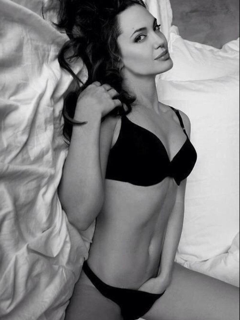 angelina-jolie-bikini-images-looking-hot-laying-on-bed-shows-off-toned-body